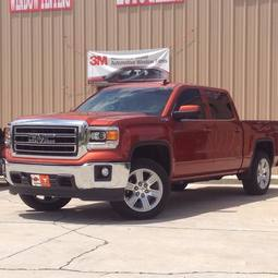red GMC truck tinted in Benton ar